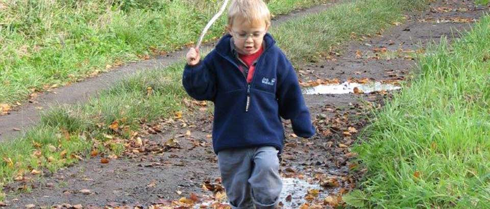 Simple pleasures, walking through puddles, with a stick!