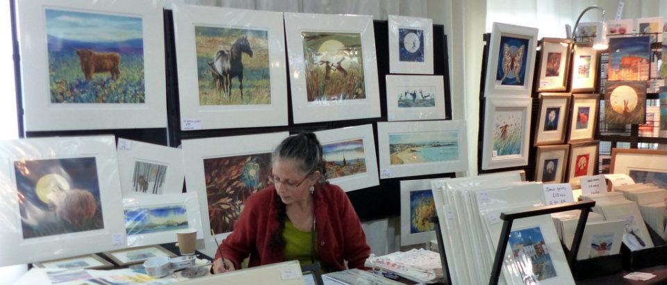 Keli Clark paints and designs