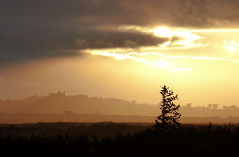 Hume Castle, below the setting sun, from Hendersyde